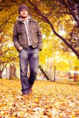 Man walking in the autumn park — Stock Photo