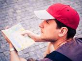 Tourist looking at   guide — Stock Photo