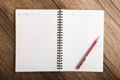 Notebook with pen on table — Stock Photo