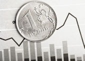 Ruble coin on fluctuating graph — Stock fotografie