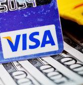 US dollar bills in wallet and Visa credit card — Stock Photo
