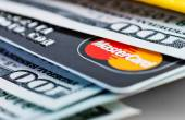 US dollar bills and Mastercard credit card in wallet. — Stock Photo