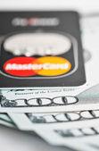 Mastercard Debit Card Over Dollar bills  — Stock Photo