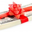 Stack of dollars with red bow — Stock Photo #59287479