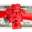 Stack of dollars with red bow — Stock Photo #59287497
