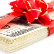 Stack of dollars with red bow — Stock Photo #59287521