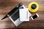 Office desk with laptop computer and coffee cup — Foto Stock