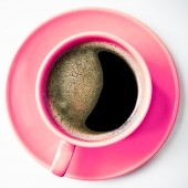 Coffee in pink cup — Stock Photo
