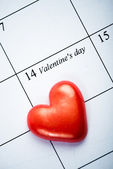 Calendar page with the red hearts — Stock Photo