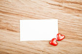 Red hearts and note — Stock Photo