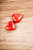 Red hearts on table — Stock Photo