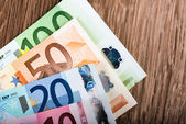 Euro banknotes on table — Stock Photo