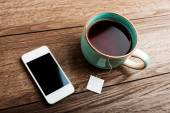 Cup of tea and phone — Stock Photo