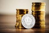 One swiss frank coin and gold money — Stock Photo