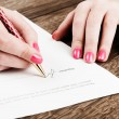 Businesswoman signing contract — Stock Photo #64055513