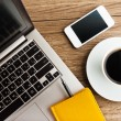 Laptop and mobile with coffee cup — Stock Photo #64055655