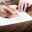 Businesswoman signing contract — Stock Photo #64056503