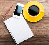 Notepad with pen, phone and coffee — Stock Photo