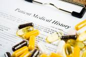 Medical document with pills — Stock Photo