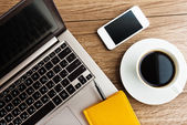 Laptop and mobile with coffee cup — Stockfoto
