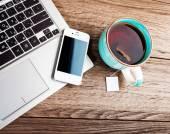 Open laptop with  cup of tea — Foto de Stock