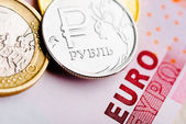 Euro and ruble coins — Stock Photo