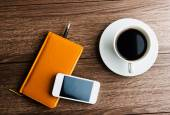 Organizer with cup of coffee — Stock Photo