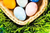 Easter eggs in basket — Stock Photo