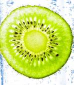 Sliced kiwi with bubbles — Stock Photo