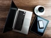 Open laptop, phone and cup of coffee — Foto de Stock