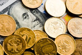 Roubles coins on dollars — Stock Photo