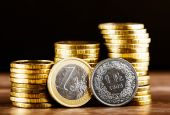 Euro coin and one swiss frank — Stock Photo