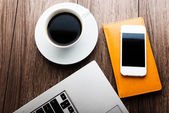 Workplace with laptop, mobile smartphone and coffee — Stock Photo