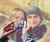 Man taking a picture of Happy couple — ストック写真