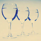 Vine glasses in row — Stock Photo