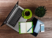 Office desk with laptop — Stock Photo