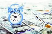 Alarm clock and dollar banknotes. — Stock Photo