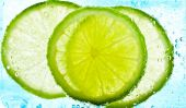 Cut limes in the water — Stock Photo