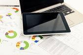 Financial reports, laptop and tablet pc — Stock Photo