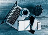 Office desk with laptop computer — Stock Photo