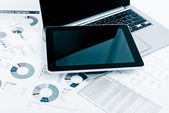 Business workplace with financial reports — Stok fotoğraf