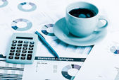 Business workplace with financial reports — Stock Photo