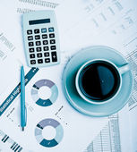 Business reports. Cup of coffee on documents. — Stock Photo