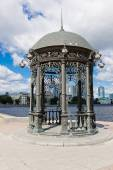 Rotunda on embankment of pond — Stock Photo