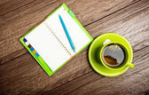 Cup of tea, pen and organizer — Stock Photo