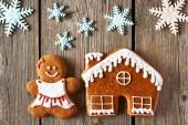 Christmas gingerbread girl and house cookies — Stock Photo