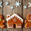 Christmas gingerbread couple and house cookies — Stock Photo #55361055