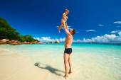 Father and two year old boy playing on beach — Stock Photo