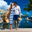 Couple kissing near poolside — Stock Photo #58419385