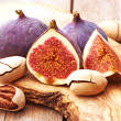 Fresh figs and nuts on wooden table — Stock Photo #59513385